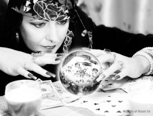 Black and white portrait of fortune-teller with chrystal ball